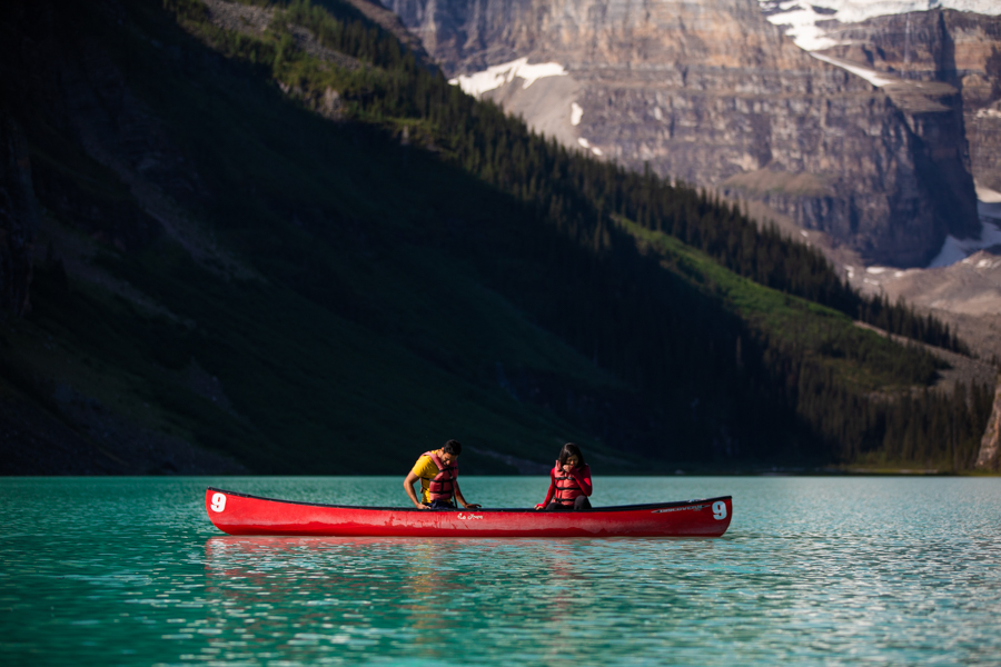 man proposing in a canoe on Lake Louise