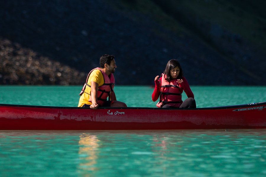 looking at wedding ring in Canoe on lake louise