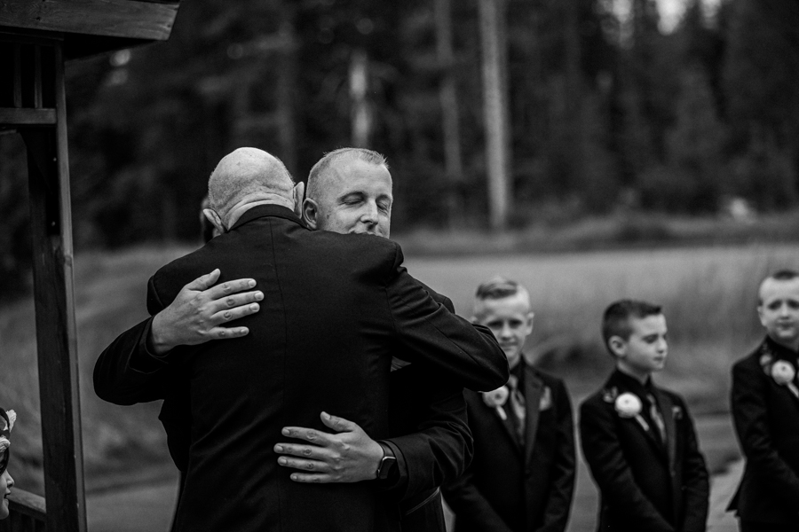 Groom hugging father at Canmore
