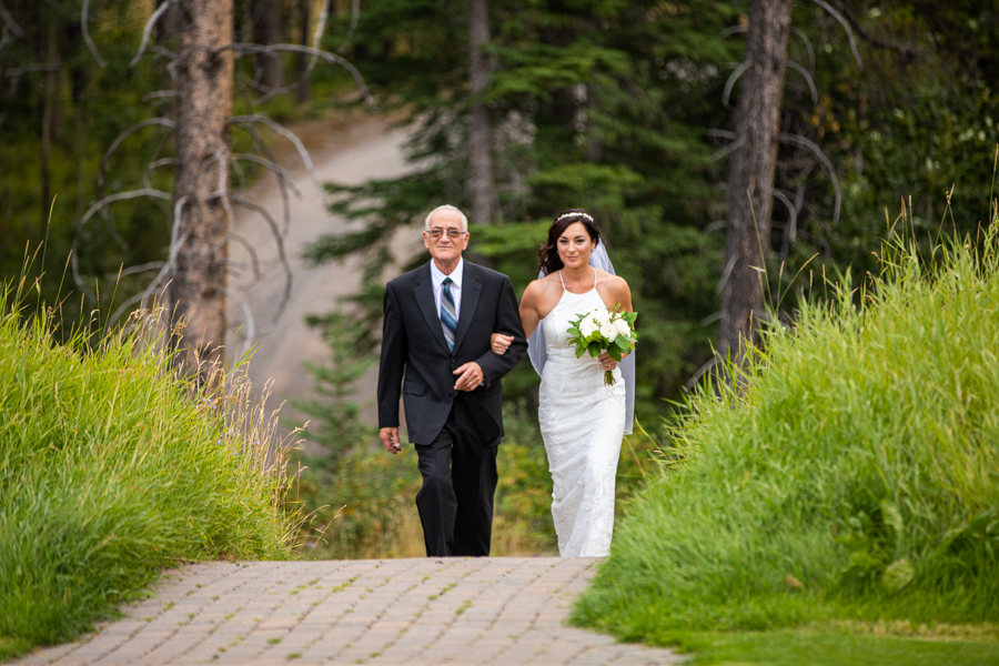 Bride coming down the aisle of Silvertip golf course wedding venue