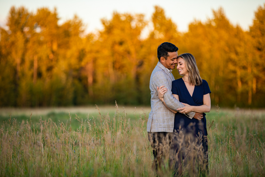 couple in a field for sunset photos