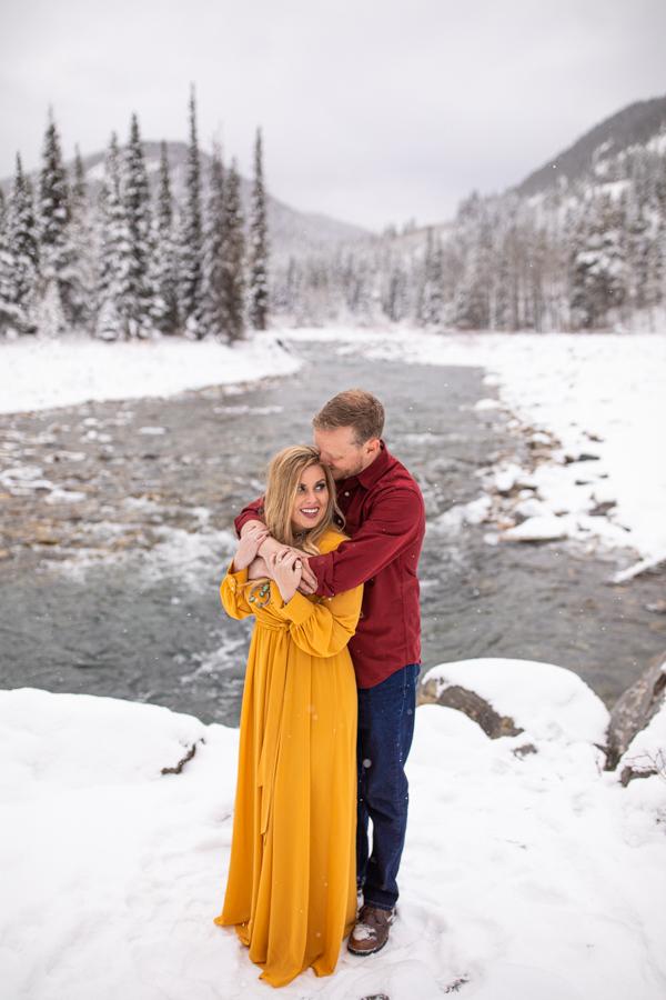 winter engagement photos at Elbow falls
