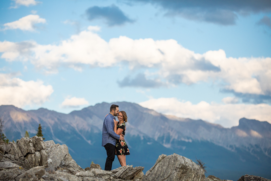 couple standing on a mountain ridge