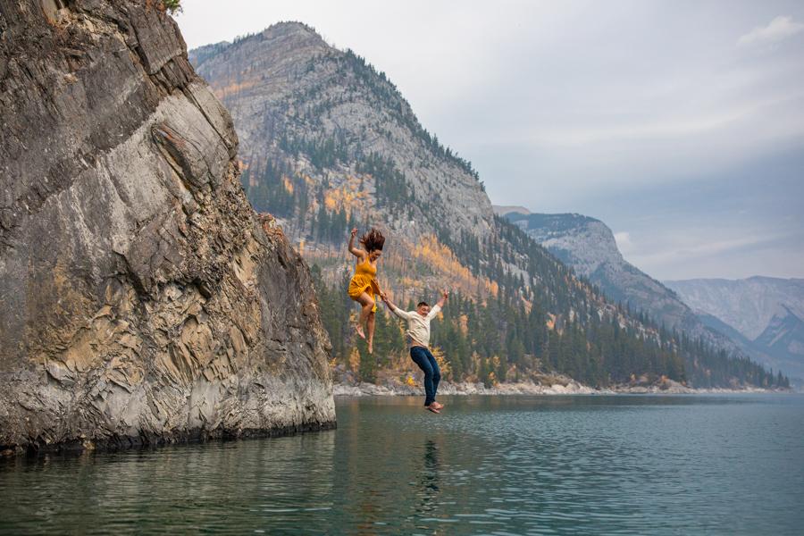 couple in the water at lake minnewanka, lake minnewanka cliff jumping couple