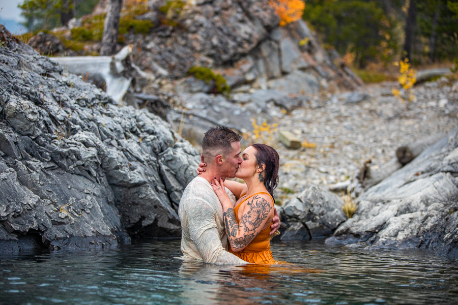 hot couple making out in the water lake minnewanka