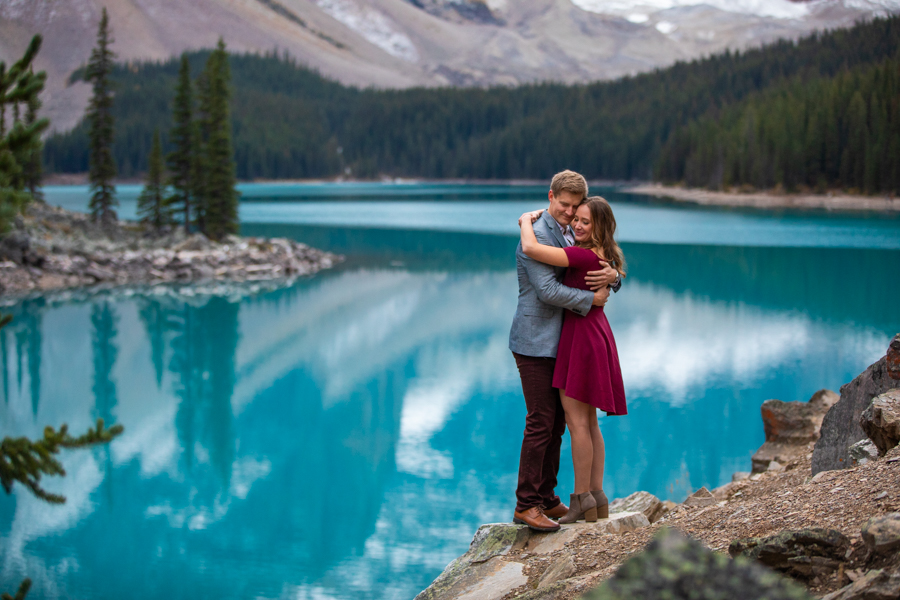 couple cuddling at moraine lake