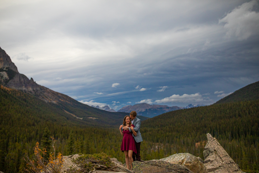 Lake Moraine Engagement Photos with blue watter