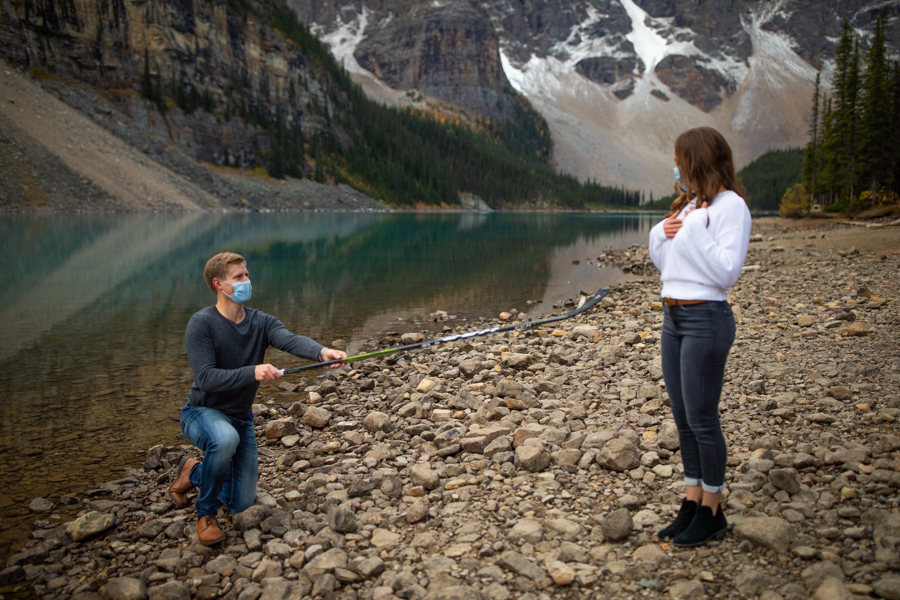 propose with a hockey stick during covid