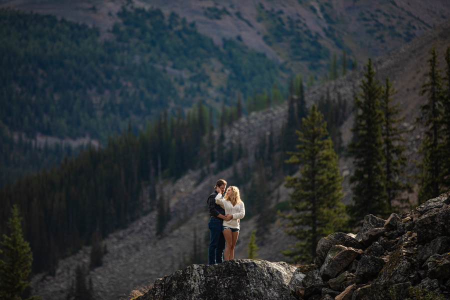 couple standing on a rock at Moraine Lake