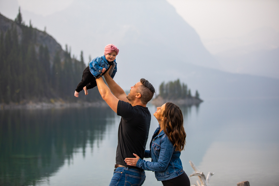 father plays airplane with daughter for family photos, Mountain Family adventure session