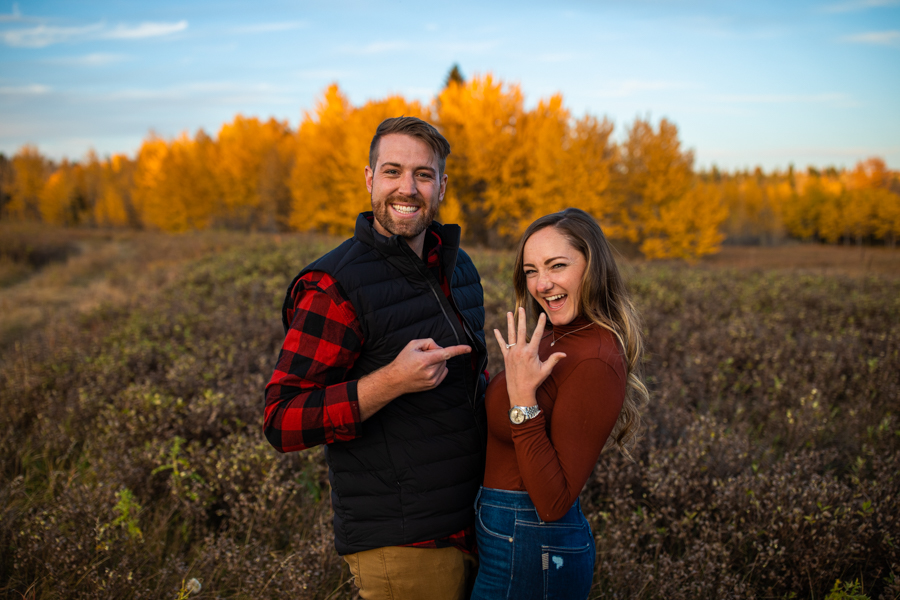 showing off the ring after saying yes to the Perfect Proposal Ideas Calgary