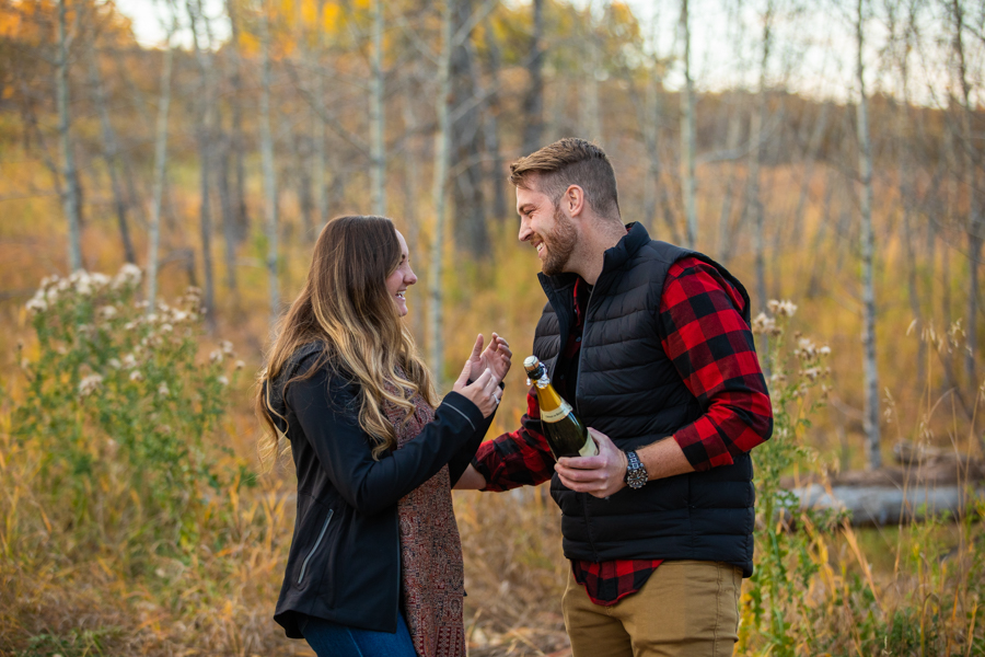 popping champagne after she says yes