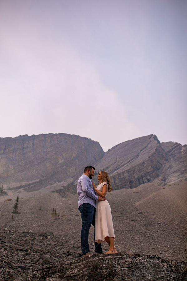 romantic couple posing in the mountains