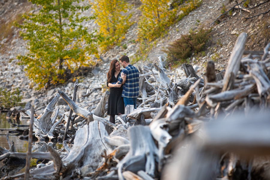 couple kissing in driftwood